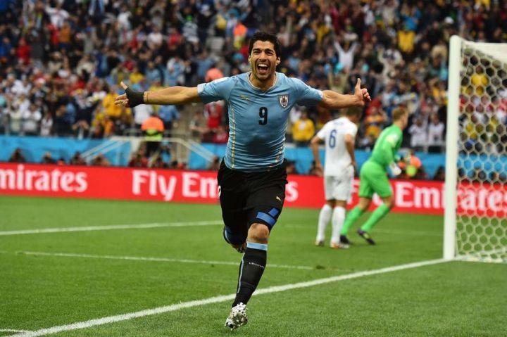 L'attaquant de Liverpool, Luis Suarez a donné l'avantage à son équipe, la Céleste.  | AFP